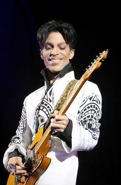 The song was composed by Prince, with credit to his father, John L. Nelson for the guitar solo based on an untitled piano piece by Nelson. Description from celebrityillustratedmagazine.com. I searched for this on bing.com/images