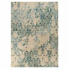 ~Add an artful touch to your living room or den with this hand-tufted New Zealand wool rug, showcasing a floral motif in teal blue~