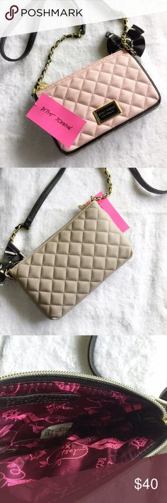 ❤️ 1 HR SALE ❤️ betsey johnson • quilted crossbody This is the cutest (and most useful!) crossbody bag/wallet from Betsey Johnson. It can hold an iPhone, lipstick and a few other small necessities when you cannot carry a big purse. The front flap has two slots for cards plus an ID slot and a small pocket for cash.   Front flap is pink and the back side is tan. Brand new with tags -- never carried.   ✔️ PRICE IS FIRM     ✖️ NO TRADES Betsey Johnson Bags Crossbody Bags