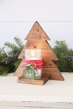 Wood Projects DIY Wood Christmas Tree Mason Jar Sconce - How to build a wood Christmas tree mason jar sconce. These budget friendly wooden Christmas trees are great for rustic decor or Christmas gifts! Wooden Christmas Decorations, Christmas Wood Crafts, Diy Christmas Gifts, Christmas Projects, Christmas Trees, Cozy Christmas, Christmas Design, Mason Jar Christmas, Homemade Christmas