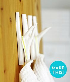 credit: Jonna Hietala [http://www.curbly.com/users/capreek/posts/12880-how-to-make-easy-diy-tree-branch-wall-hooks]