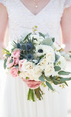 This spring bouquet was created for an early March wedding in Calgary, Alberta. The bouquet was designed with panda anemones, navy eryngium thistle, flowering scabiosa, spray roses, dusty miller and seeded eucalyptus.  Photo: @EmilyExon  Bouquet: www.flowersbyjanie.com