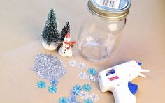 If you're looking for an absolutely adorable holiday craft to do by yourself or with your kids, here is the perfect (and simple) DIY craft project: Mason Jar Snow Globes. What I love about these is if you're on a budget, you can round up items in your home and