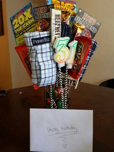 Made a gift bouquet for my boyfriends 31st birthday! Scratch tickets, boxers, and candies all attached to cute straws put in a vase of wrapped candies. He loved it! :)