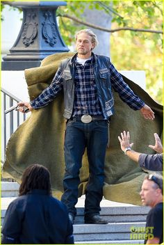 Charlie Hunnam points a gun while going undercover for a scene in the final season of his hit show Sons of Anarchy on Tuesday (October 28 2014) in Pasadena, Calif.