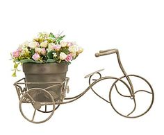 Bicicleta decorativa vintage con rosas