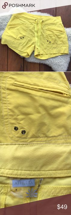 """{Athleta} Sunshine Yellow Board Shorts 4 EUC! Minor snag in back stitching. A couple pinhole stains on rear end, not noticeable (all pictured). Beautiful sunshine or lemon yellow! Sunny and happy! Perfect for the beach, pool, lake, etc! Great for surfing, stand up paddle boarding, boating, you name it! 16"""" waist, 18"""" hips, 9"""" rise, 3"""" inseam. Fabric content + Care shown in photos. Bundle and save! Offers warmly welcomed. Athleta Shorts"""