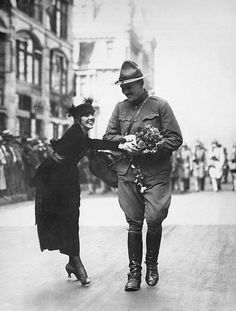 WORLD WAR I: Welcome Home! New York, New York. August 7, 1919. A young woman giving a bouquet of flowers to a returning WWI soldier in the Welcome Home parade