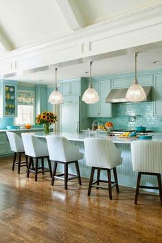 Modern Coastal Kitchen With Fabulous Shades of Painted Aqua And Gorgeous Glass Backlash