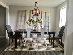 My eclectic dining space I gave the small wall more dramatic warm feel with vintage salvaged French doors.  New wood light fixture offsets the modern industrial chairs.  Woven area rug grounds the space.  Love it!