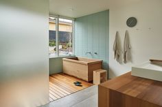 The blissful Western red cedar soaking tub in the master bathroom is traditional Japanese design, says Chad Rollins of Dovetail General Contractors. (Benjamin Benschneider/The Seattle Times)