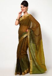 Gorgeously charming is what you will look at the next social do wearing this beautiful green saree from Bunkar. Its supernet fabric ascertains a comfortable wear, while the exquisite mirror work highlights pure elegance. This saree measures 6.3 m, including a 0.8 m blouse piece.