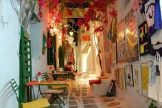 On the picturesque island of Ios, and especially in Chora, colours abound. Walking on the alleys of Ios Island , your eye may catch a parti. Mykonos, Santorini, Places Around The World, Around The Worlds, Places To See, Places Ive Been, Wonderful Places, Beautiful Places, Travel Log