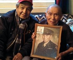 From Facebook page - America Honors & Remembers - Recent photo of Navajo Code Talker Peter MacDonald (left) and Navajo Code Talker Fleming Begay (right). Code Talker Begay, 92, is holding his Marine photo from WWII. Mr. Begay was also a successful businessman upon his return to the Navajo Nation.