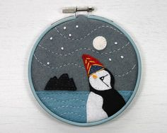 Moon-gazing Puffin is a miniature felt embroidery of a puffin under the full moon, with Skellig Michael in the background. The Skelligs are the wild and isolated islands off the coast of Kerry, which are a haven for seabirds. I appliqued felt shapes to the background, then embroidered