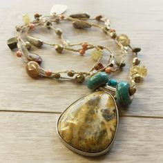 I totally channeled my inner hippie when I created this amazing bohemian necklace. Complete with balance charm and large yellow agate in a silver setting as the focal pendant, I just love it and I've added natural citrine too.