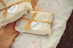 Picnic style reception with gourmet sandwiches, wrapped up - so cute!