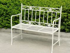 Traditional White Metal Outdoor Patio Bench Design with Beauty Green Leaves