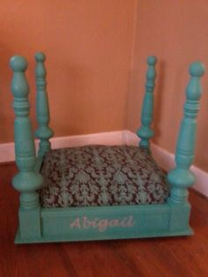This is an end table turned into a four poster dog bed. It has that canopy bed look.