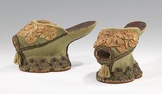 The heel-less shoes of the Middle Ages, termed Chopines, were primarily worn by women in Venice to elevate the wearer above her surroundings and increase her visibility amongst a crowd. Furthermore, Chopines also functioned as shoes which raised the wearer above dirty streets, protecting her from debris and unsanitary conditions. (shoes circa 1600)