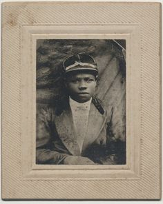 African American Jockey Horse Racing cabinet card ~ I cannot say for sure, BUT THIS DOES BEAR SOME RESEMBLANCE to JAMES PERKINS, who WON the KENTUCKY DERBY in 1895 at the age of 15. This image probably dates to 1900-1910