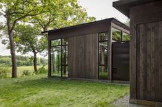"""Altus designs Minnesota home and """"shiny shed"""" to blend with the forest"""