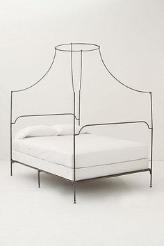 I dream of this bed. One day! Anthropologie Italian Campaign Canopy Bed