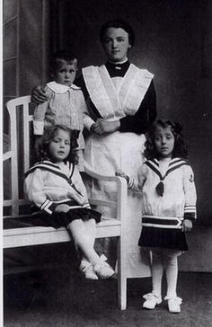 Two girls in sailor suits, with their little brother and a servant.