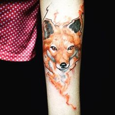 Little abstract designed colored forearm tattoo of fox head