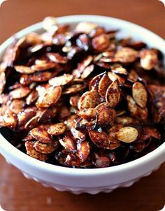 These sweet salty roasted pumpkin seeds are the perfect snack to make after carving pumpkins. It& the perfect balance of sweet, salty and cinnamon flavor. Fall Recipes, Holiday Recipes, Snack Recipes, Cooking Recipes, Yummy Recipes, Roast Pumpkin, Pumpkin Spice, Oven Roasted Pumpkin Seeds, Pumpkin Bread