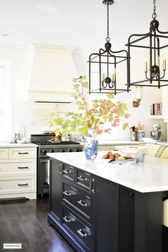 Fall Home Tour - casual elegant black and white kitchen with large black island and lantern style pendant lighting. Fall Home Tour - casual elegant black and white kitchen with large black island and lantern style pendant lighting. Kitchen Chandelier, Kitchen Pendants, Black Kitchens, Cool Kitchens, Kitchen Black, Modern Kitchen Lighting, Rustic Country Kitchens, Farmhouse Kitchens, Modern Kitchen Cabinets