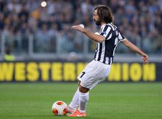 Andrea Pirlo of Juventus scores the first goal during the UEFA Europa League quarter final match between Juventus and Olympique Lyonnais at ...