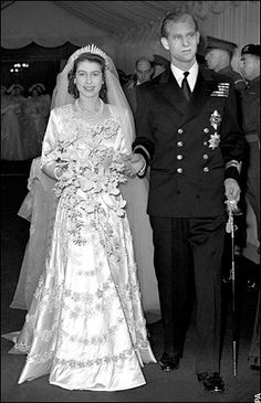 "Lieutenant Philip Mountbatten and his bride, Princess Elizabeth of York, on their wedding day.  On the morning of his wedding Philip, who'd renounced his Greek and Danish titles, was giving the style ""His Royal Highness"" and the title ""Duke of Edinburgh"" by his new father-in-law, King George VI."