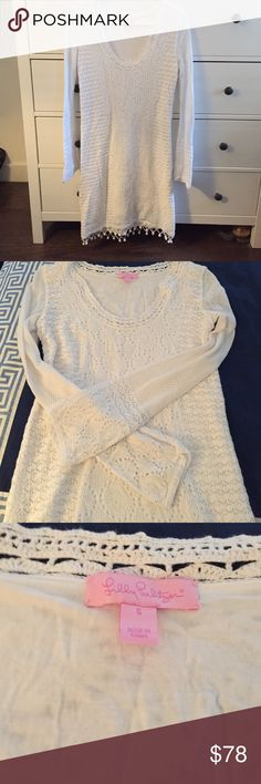 Lilly Pulitzer Athena Crochet Sweater Dress Scoop neck white Lilly Pulitzer crochet knit dress with Pom Pom detailing at hem. Knew length with flattering long sleeves this dress is a must for summer! Minimally worn and in excellent condition. Lilly Pulitzer Dresses