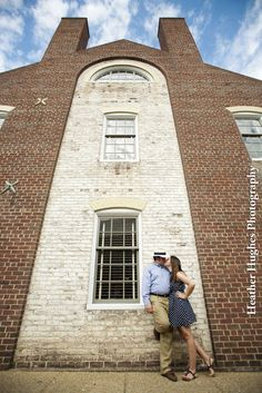 Creative engagement portrait in Colonial Williamsburg by Heather Hughes Photography.