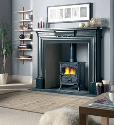 Convert your fireplace into a wood burning stove. These are great for heat and cooking during a power outage situation. Fireplace Surrounds, Fireplace Design, Fireplace Ideas, Log Burning Stoves, Wood Burning, Wood Burner Fireplace, Faux Fireplace, Stoves For Sale, Victorian Fireplace