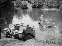 "Royal Army – Universal Bren Gun Carrier – Were Used to Transporting Personnel and Equipment. Mostly to Support Weapons, or as Machine Gun Platforms - Armament: 1 x .303 cal ""Bren"" Machine Gun or 1 x .55 cal (14.3mm) ""Boys"" Anti-Tank Rife, 1 x .50 cal ""M2 Browning"" Machine Gun, 1 x 2 Inch or 3 Inch Mortar or Infantry Anti-Tank Projector - Seen the Gun Carriers of the Welsh Guards Fording a Stream, 13 July, 1940"