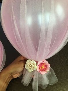 DIY Tulle Balloons for a baby shower or wedding. Cover 3 ft. Ballons with Tulle, string and synthetic flowers.