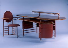 Frank Lloyd Wright (American, 1867–1959) | Steelcase, Inc. (Grand Rapids, Michigan, established 1912), manufacturer | Desk and Chair | 1936-1939 | Enameled steel, walnut, and brass-plating | Purchase with funds from the Decorative Arts Endowment | 1984.371.1-2 V