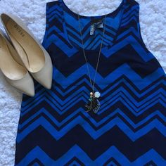 Chevron blue tank This is a flowy tank that is perfect for warm weather! This can easily be dressed up or down! Fun & flirt Tops Tank Tops