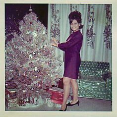 Here's a totally Christmas photo, featuring an aluminum Christmas tree, a young lady with a fashionable beehive hair style, and (drum roll!) a chair covered with a clear plastic slipcover. Ghost Of Christmas Past, Old Christmas, Old Fashioned Christmas, Retro Christmas, Christmas And New Year, Christmas Trees, Family Christmas, Silver Christmas, Modern Christmas