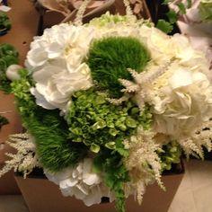 Bride's bouquet: white hydrangea, trachelium, white garden roses, green hydrangea, white astilbe, and maiden hair fern
