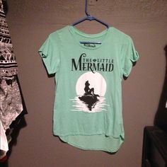 the little mermaid tee like new worn twice super cute & comfy mint green color high low effect as well!   ✋PLEASE! stop and read closet info listing of you haven't! ♻️TRADE VALUE: $25 ✅good offers accepted!!!!!!!! shipping same or next day-any purchases made on Friday after 2pm will be shipped the following Monday. Disney Tops Tees - Short Sleeve