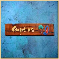 Unique and exclusive sleeper wood door nameplate with handmade terra cotta face mask and wooden alphabets