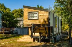 Very cool, custom tiny home. Best part? It's built on a giant gooseneck flatbed trailer, so it is as mobile as it is stylish.