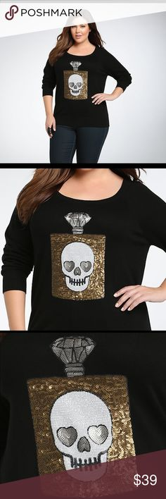 """Torrid Sequin Skull Sweater 2X NWT Brand new with tags sweater by Torrid in Size 2. Black with gold sequins on the design. Deets below, originally purchased for $54.50. *tank top and necklace not included*  Size 2 is equivalent to 2X / 18/20 / 46"""" - 50"""" BUST / 40"""" - 44"""" WAIST / 50"""" - 54"""" LOW HIP.  Made with Cotton, wash cold and dry flat! Model is wearing Size 1. torrid Sweaters Crew & Scoop Necks"""