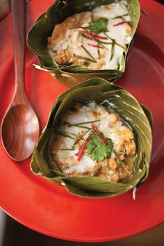 Hor Mok (Steamed Thai Fish Custard) by Saveur. Typically steamed in intricately folded banana leaves, these Thai fish custards are baked in leaf-lined ramekins set in a water bath. Basil Recipes, Thai Recipes, Fish Recipes, Seafood Recipes, Laos Recipes, Thai Cooking, Cooking Recipes, Asian Cooking, Tamales