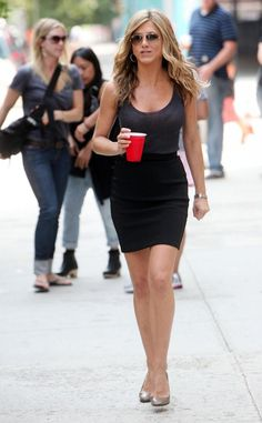 Jennifer Aniston street style in a black pencil skirt and nude pumps.