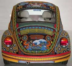 "StudioKat Designs You're probably thinking this VW was ""yarn-bombed"" or modge-podged, but you'd be wrong on BOTH counts! This VW was actually BEADED! It took 8 bead artisans over 9000 hours to accomplish this look!"