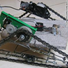 Fundi Bots student Victor Kawagga created this remote controlled robot called Attobot using 90% local or recycled materials. The wheels/tracks are bicycle chains and the frame is made of wire and paper mache.